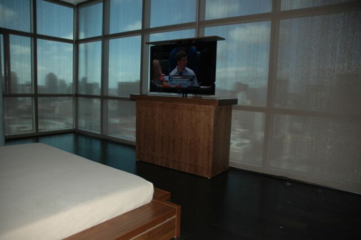 Ocean front TV lift cabinets help save the view