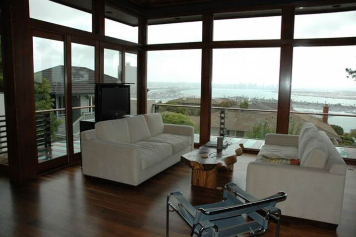 living room in home with view showing tv in up position after raised out of television studio custom lift