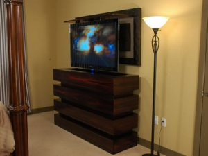 55 inch TV in bedroom rises out of contemporary Le Bloc