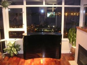 Coast Black lacquer lift cabinet hiding TV but revealing view