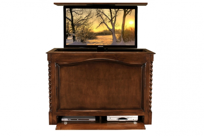 Coronado Antique Caramel pop up TV lift cabinet furniture has a component section that is located at the bottom. You can place a DVD and cable box their.