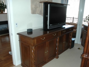 Marin 4 door carved traditional pop up TV in high rise condo