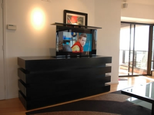 Modern Cabinet with 55 inch TV lift against wall