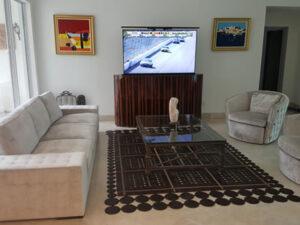 Oval hidden TV lift cabinet furniture focal piece