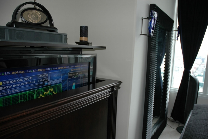 here is a ritz tv lift design in a home up against wall in a bedroom tv lift furniture