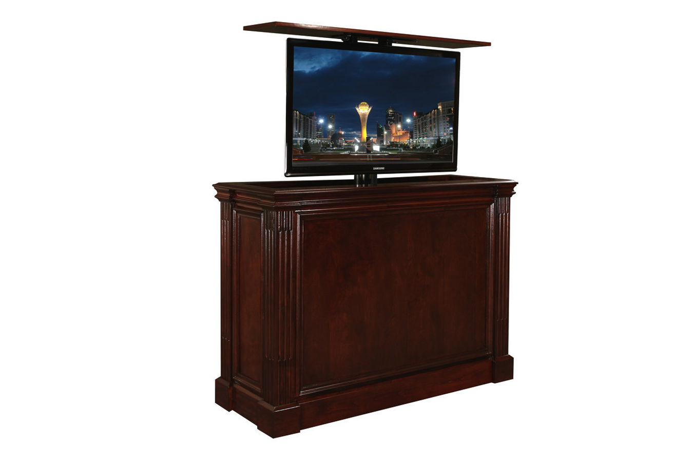 Ritz TV lift kit cabinet furniture is US Made, comes in 20 different finishes, has a 10 year warranty and holds up to 65 inch flat screens. End of bed or against the wall.