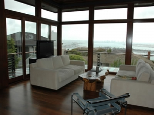Save the view with TV lift Studio behind couch