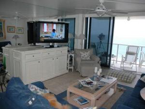 Scarlet furniture hides flat screen in beach home