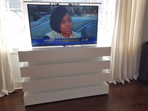 Stunning white Le Bloc custom TV lift cabinet