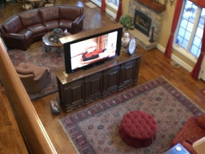 View from upstairs of center of room TV lift pop up holding 70 inch