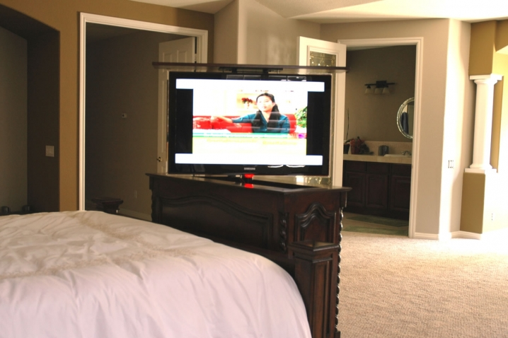 Beautiful end of bed furniture with TV hidden inside it