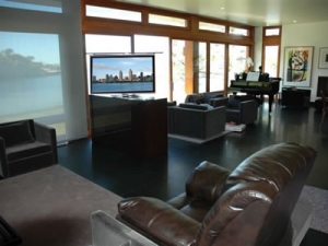 ocean front home saves view and TV watched from multiple spaces